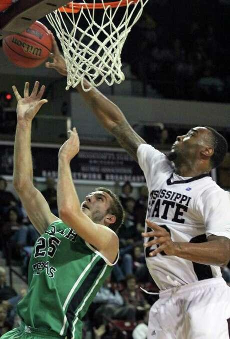 Mississippi State's Arnett Moultrie blocks a shot by North Texas' Niko Stojiljkovic in the second half. Photo: AP