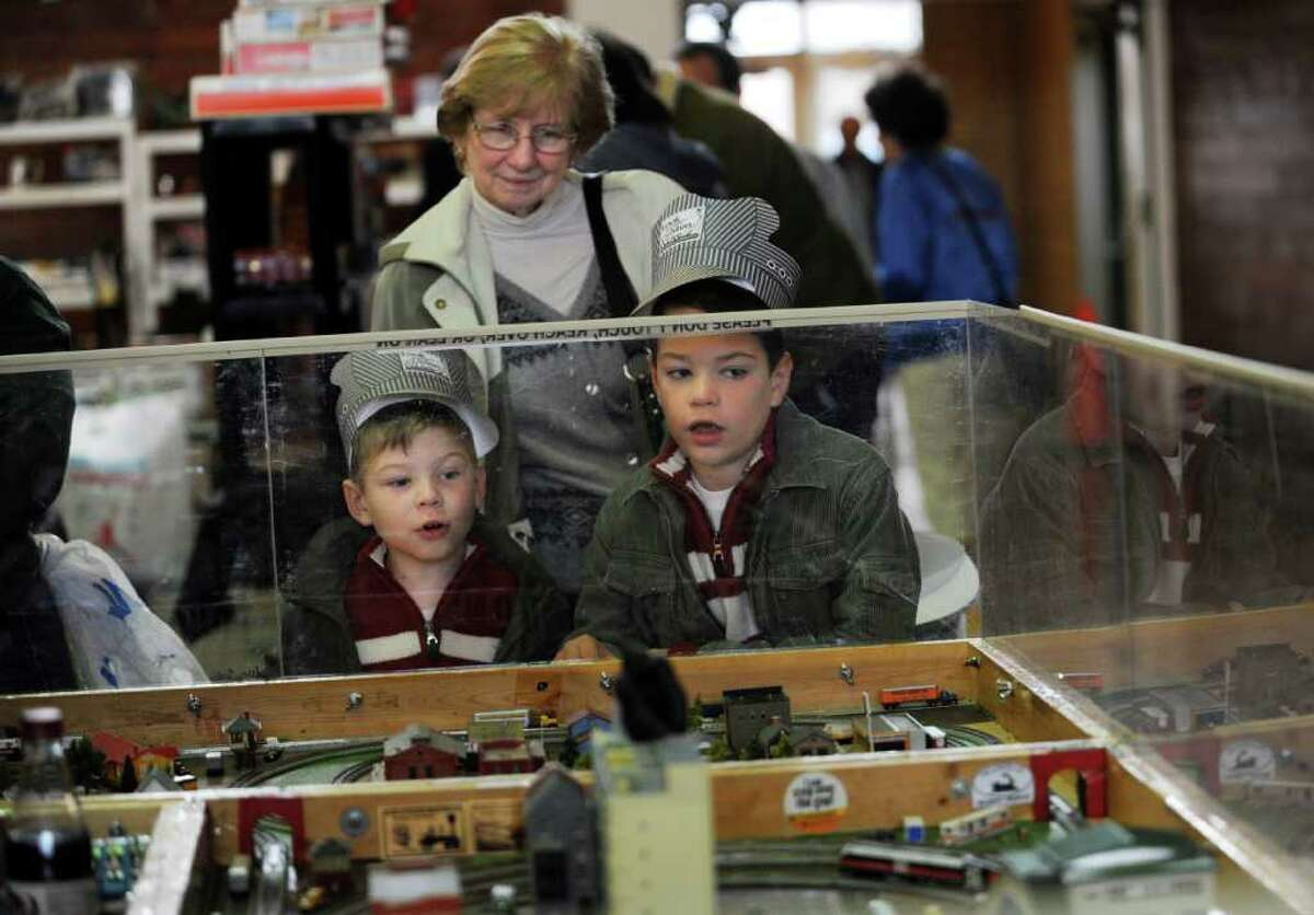 Shane Barton, 5, left, of New Fairfield, their grandmother Joan Downey of Oxford and brother Aidan, 8, look at Joel's Trainville Hobby Depot N-Scale at the Westchester Model Railroad Club's Fall Train Meet at Eastern Greenwich Civic Center Sunday, Nov. 27, 2011.