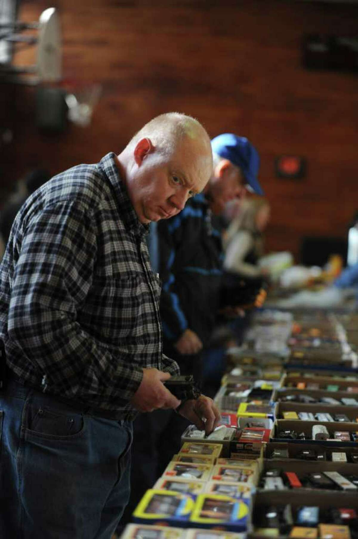 Ken Grogan, of Hartsdale, N.Y., looks at model trains at the Westchester Model Railroad Club's Fall Train Meet at Eastern Greenwich Civic Center Sunday, Nov. 27, 2011.