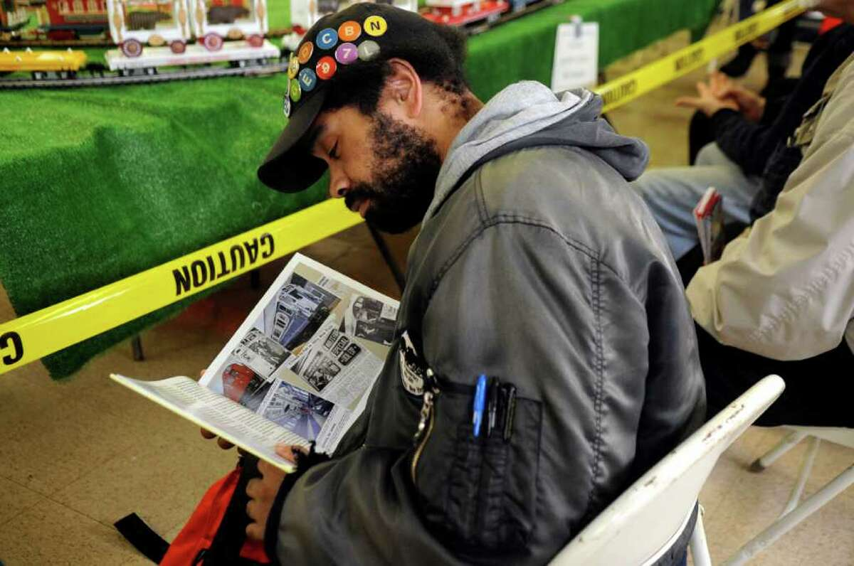 McDonald Reid Jr., of Bronx, N.Y., looks at a book about trains at the Westchester Model Railroad Club's Fall Train Meet at Eastern Greenwich Civic Center Sunday, Nov. 27, 2011.