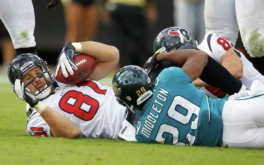 Karen Warren photos: Chronicle STOP SIGN: Texans tight end Owen Daniels (81) is dragged down by Jaguars cornerback William Middleton (29) in the third quarter Sunday. Photo: Karen Warren / © 2011 Houston Chronicle