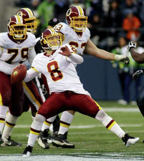Redskins quarterback Rex Grossman launches a 50-yard touchdown pass, on of his two scores through the air at Seattle. Photo: AP