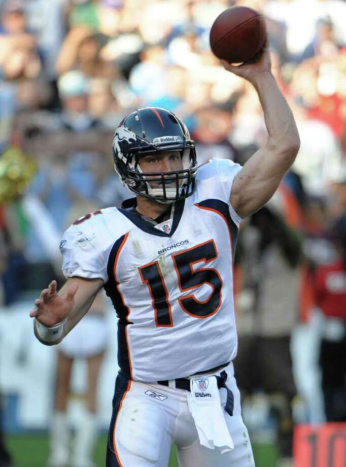 DENIS POROY: AP STRONG-ARMING IT: Tim Tebow led the Broncos to a victory with more than his legs Sunday, when he passed for 143 yards. Photo: Denis Poroy / FR59680 AP