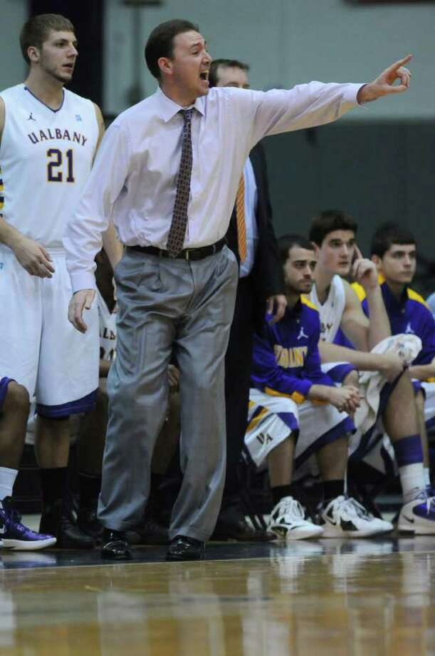 UAlbany head coach Will Brown yells instructions during the first half of their 81-62 victory over Fairleigh Dickinson at the SEFCU Arena on Sunday Nov. 27, 2011 in Albany, NY. Blake Metcalf is at left. (Philip Kamrass / Times Union ) Photo: Philip Kamrass / 00015354A