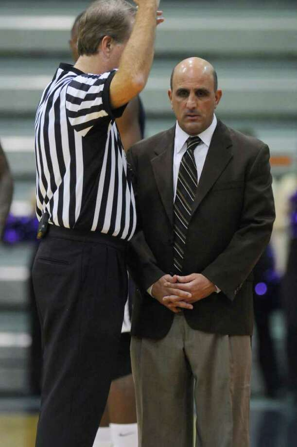 Fairleigh Dickinson men's basketball coach Greg Vetrone listens to an official during their 81-62 loss to UAlbany at the SEFCU Arena on Sunday Nov. 27, 2011 in Albany, NY. (Philip Kamrass / Times Union ) Photo: Philip Kamrass / 00015354A