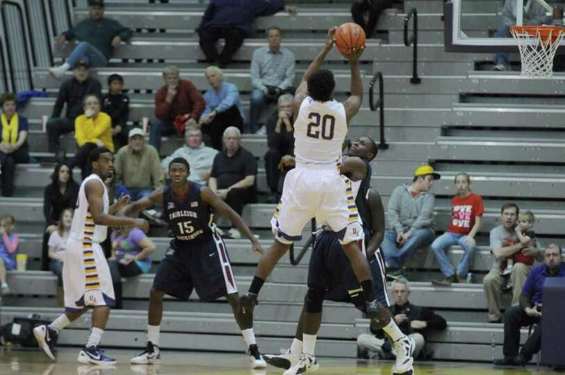UAlbany's Gerardo Suero puts up a shot during the second half of UAlbany's 81-62 victory over Fairle