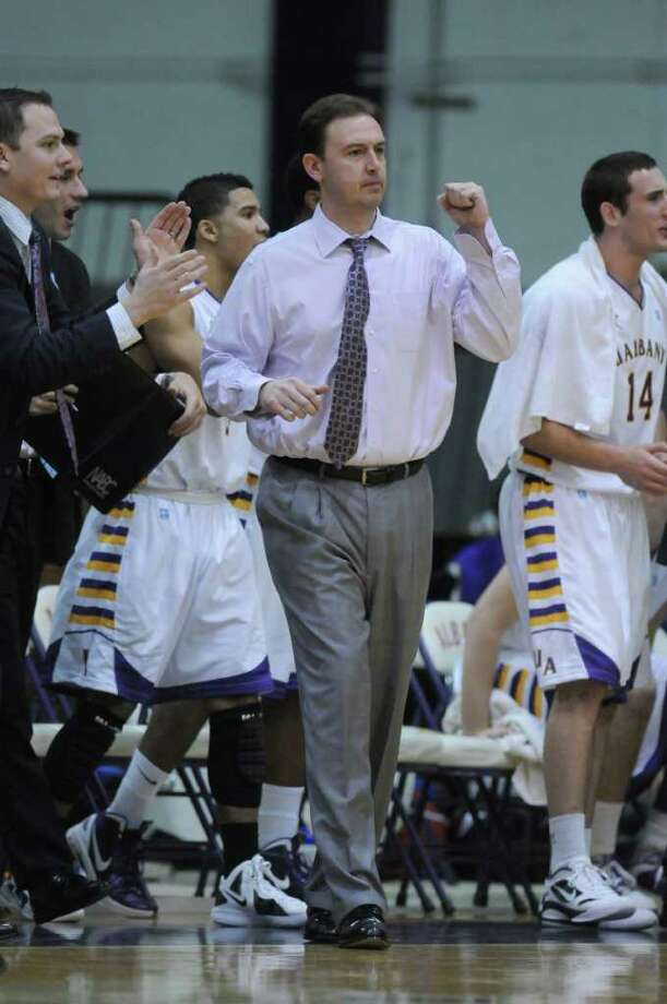 UAlbany head coach Will Brown celebrates a good moment in the second half of their 81-62 victory over Fairleigh Dickinson at the SEFCU Arena on Sunday Nov. 27, 2011 in Albany, NY. (Philip Kamrass / Times Union ) Photo: Philip Kamrass / 00015354A