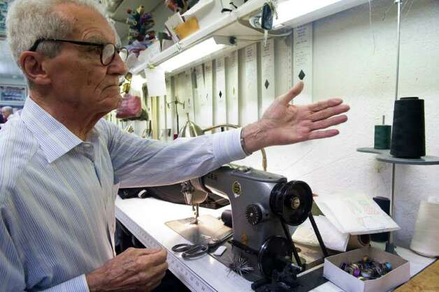 Tailor Tom D'Agostino adjusts his thread as he works in Luigi Giorno's  shop Serpe Bros. Custom Tailors Formal Rentals on Bedford Street in Stamford, Conn., November 22, 2011. Photo: Keelin Daly