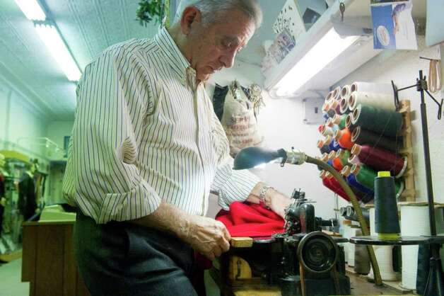 Tailor Luigi Giorno at work in his shop Serpe Bros. Custom Tailors Formal Rentals on Bedford Street in Stamford, Conn., November 22, 2011. Photo: Keelin Daly