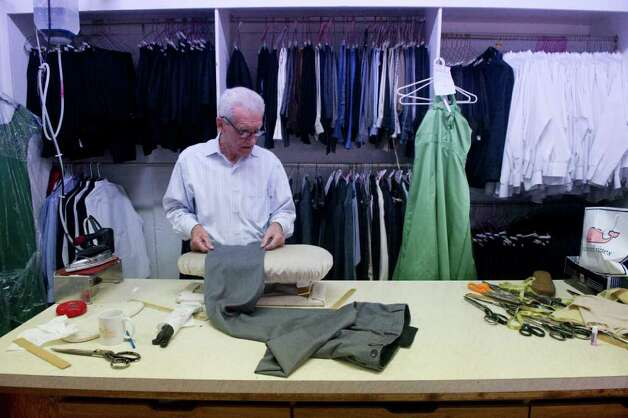 Tailor Tom D'Agostino at work in Luigi Giorno's  shop Serpe Bros. Custom Tailors Formal Rentals on Bedford Street in Stamford, Conn., November 22, 2011. Photo: Keelin Daly