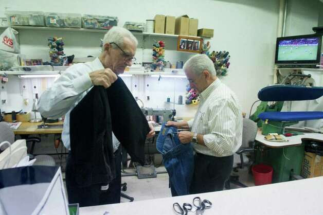 Luigi Giorno, right, owner of Serpe Bros. Custom Tailors Formal Rentals and tailor Tom D'Agostino at work in the shop on Bedford Street in Stamford, Conn., November 22, 2011. Photo: Keelin Daly