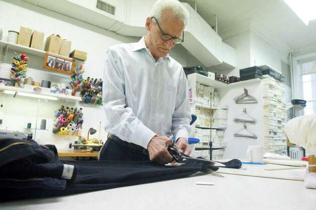 Tailor Tom D'Agostino shortens a pair of pants at Serpe Bros. Custom Tailors Formal Rentals on Bedford Street in Stamford, Conn., November 22, 2011. Photo: Keelin Daly