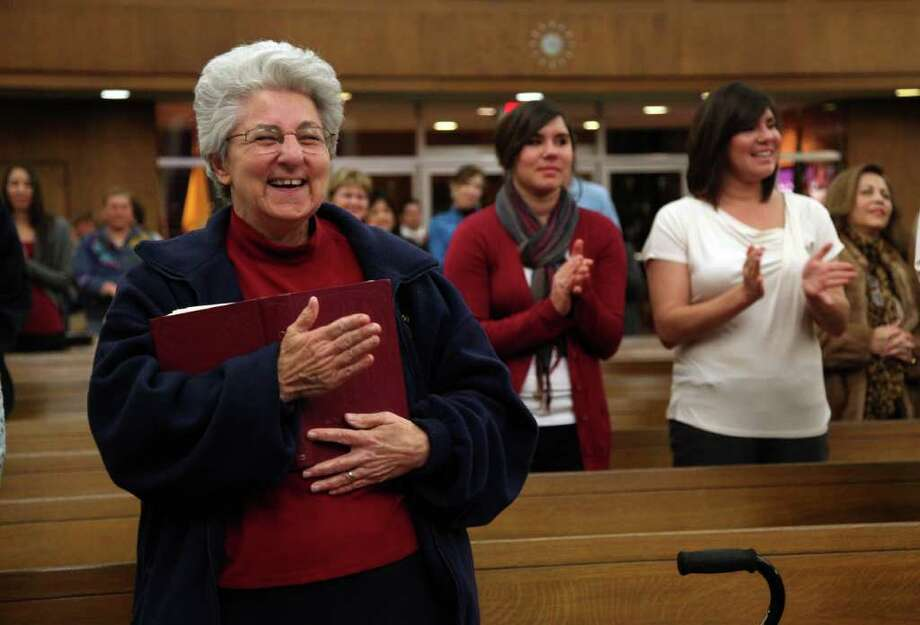 """Sr. Sharon Karam RSCJ laughs after Father Donald Nesti says """"What I have learned today is that I know I have the spirit"""" after the congregation repeated the revised response of """"And with your spirit""""  during mass at St. Teresa Catholic Church on Sunday, Nov. 27, 2011, in Houston. Catholic clergy have been preparing for months in preparations for revisions to the Roman Missal.  """"You have to get use it. It's going to take practice. I even missed responses myself"""" says Sister Sharon Karam RSCJ.  ( Mayra Beltran / Houston Chronicle ) Photo: Mayra Beltran / © 2011 Houston Chronicle"""