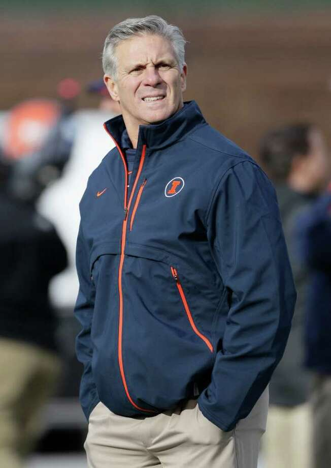 FILE - In this Nov. 20, 2010, file photo, Illinois football coach Ron Zook looks around as his team warms up before an NCAA college football game against Northwestern in Chicago. Zook was fired Sunday, Nov. 27, 2011, after the Illini followed a 6-0 start to this season with a six-game losing streak. (AP Photo/Nam Y. Huh, File) Photo: Nam Y. Huh / AP2010