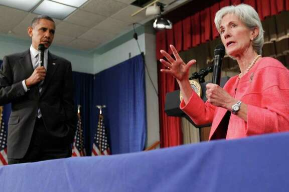 "FILE - In this June 8, 2010 file photo, President Barack Obama listens as Health and Human Services Secretary Kathleen Sebelius speaks during a town hall meeting on the Affordable Care Act, at the Holiday Park Multipurpose Senior Center in Wheaton, Md. Medicare's prescription coverage gap is getting noticeably smaller and easier to manage this year for millions of older and disabled people with high drug costs. The ""doughnut hole""will shrink about 40 percent for those unlucky enough to land in it, according to new Medicare figures provided in response to a request from The Associated Press.  (AP Photo/Alex Brandon, File)"