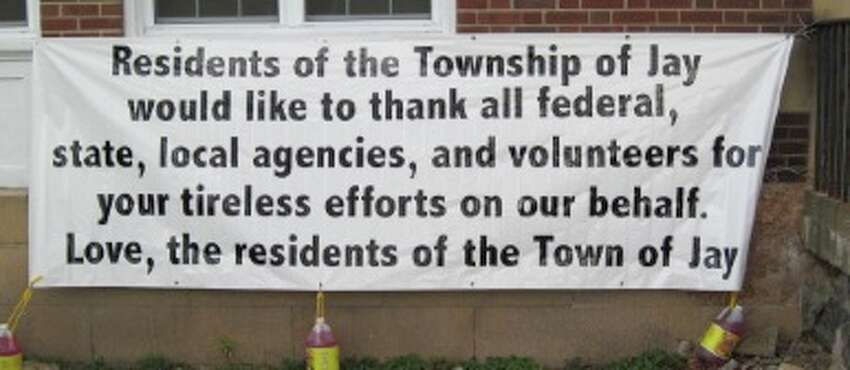 Sign thanking those who helped following Tropical Storm Irene hangs on Jay town offices in Au Sable Forks, NY. (Rick Karlin/Times Union)