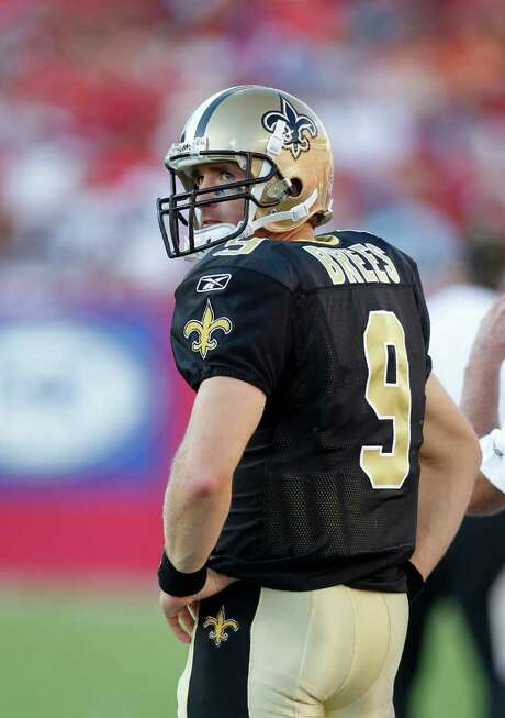 New Orleans Saints quarterback Drew Brees (9) watches the clock wind down in a game between the Saints and the Tampa Bay BuccaneersThe Buccaneers defeated the Saints 26-20 in an NFL game, Sunday, Oct. 16, 2011 in Tampa, Fla. (AP Photo/Margaret Bowles) Photo: Margaret Bowles / FR158735 AP