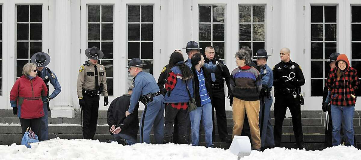 Protesters are arrested on the lawn of the Blaine House during a rally by Occupy Augusta, Sunday, Nov. 27, 2011, in Augusta, Maine. Police say nine people were charged with criminal trespass and failure to disperse after refusing to leave the lawn of the governor's mansion. (AP Photo/The Kennebec Journal, Andy Molloy)
