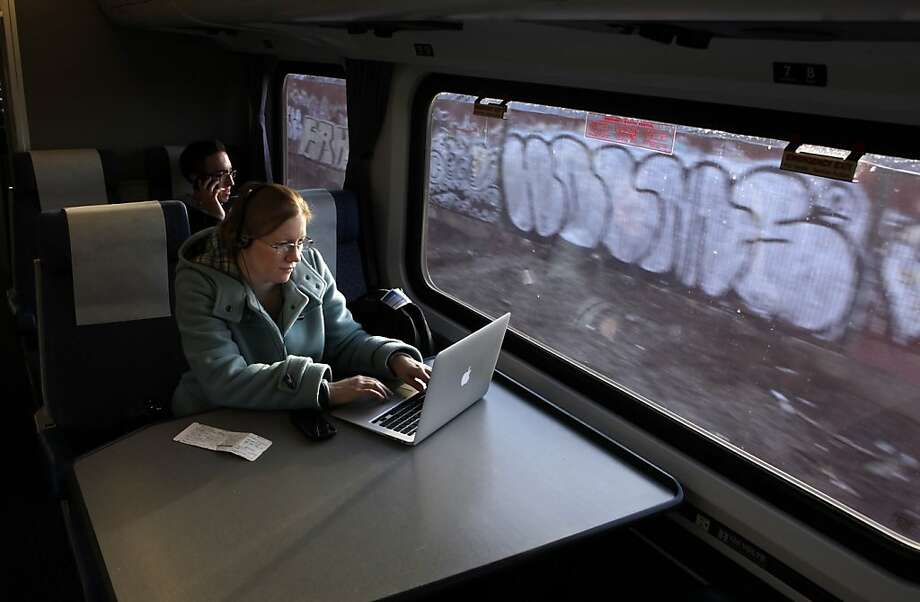 Amber Sass of Sacramento uses her laptop while on the Capitol Corridor Amtrak Train on her way home from San Francisco. While high-speed rail in California is getting all the attention, the state's lower-speed intercity trains are seeing a boom in popularity. Trains like the Capitol Corridor, shown here on Thursday, December 23, 2010,  in Emeryville, Calif., have seen a double digit rise in passengers. Ran on: 01-05-2011 Amber Sass of Sacramento uses her laptop on the Capitol Corridor Amtrak Train, heading home from San Francisco. Ran on: 01-05-2011 Amber Sass of Sacramento uses her laptop on the Capitol Corridor Amtrak Train, heading home from San Francisco. Photo: Carlos Avila Gonzalez, The Chronicle