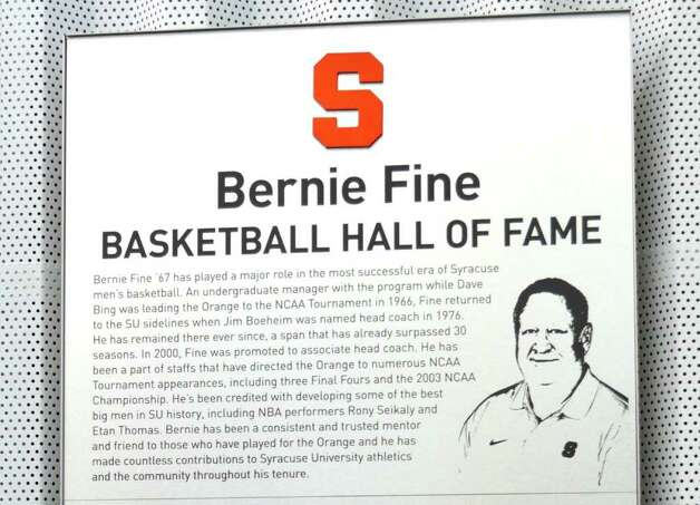 A plaque honoring Bernie Fine, Syracuse University men's basketball associate coach, hangs in the Syracuse University practice facility  in Syracuse, N.Y., Friday, Nov. 18, 2011. Fine was placed on administrative leave, Thursday, Nov. 17,  after old child molesting allegations resurfaced. Photo: Kevin Rivoli, AP / FR60349 AP