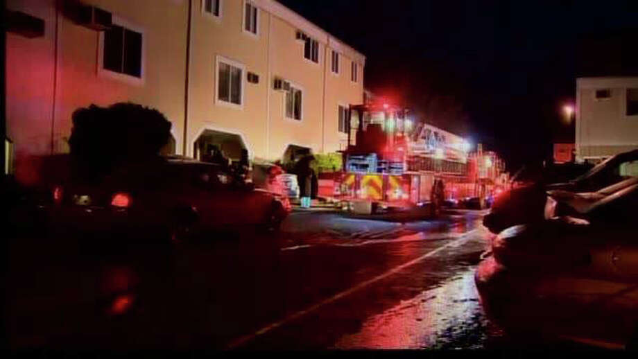 Firefighters Monday morning, Nov. 28, 2011 knocked out a small fire at a Norwalk condo. The fire was reported at St. Paul Terrace at 28 Martin Luther King Drive. Photo: WTNH