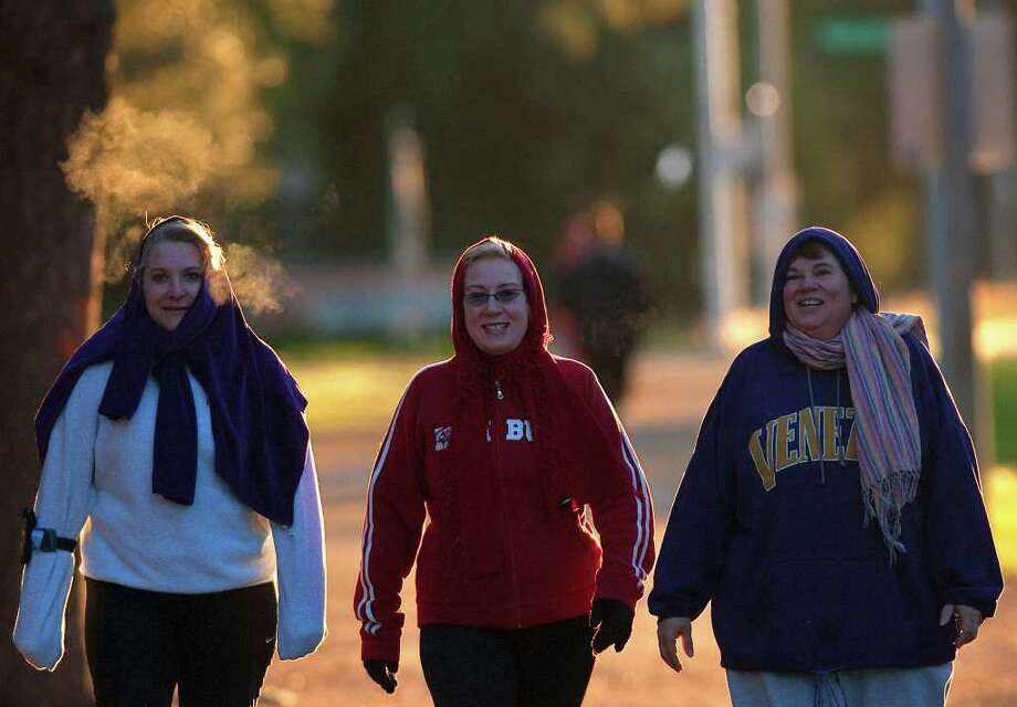 Susan Collins, left, Patti Moore, center, and Marian LaSalle, right, walk the loop at Memorial Park Monday, Nov. 28, 2011, in Houston. Cody Duty / Houston Chronicle) Photo: Cody Duty / © 2011 Houston Chronicle