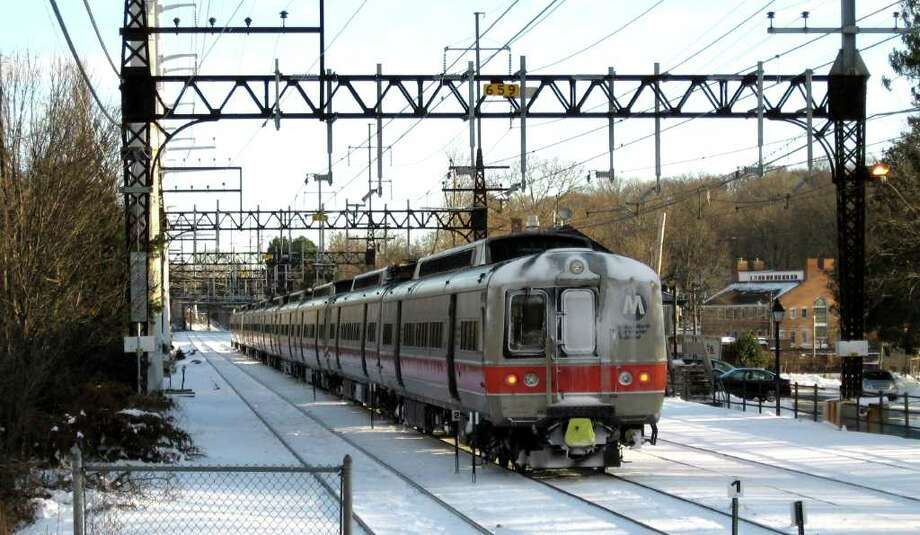 The oldest of the M-2 rail cars that Metro North uses on its New Haven line are 39 years old, and they should have been retired about a decade ago. Breakdowns are frequent, particularly when it snows. This northbound M-2 train is near the Southport railroad station on Tuseday December 28, 2010. Photo: John Burgeson, ST / Connecticut Post