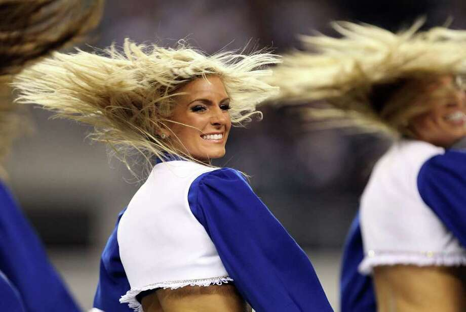 ARLINGTON, TX - DECEMBER 12:  A Dallas Cowboys cheerleader performs at Cowboys Stadium on December 12, 2010 in Arlington, Texas. Photo: Ronald Martinez, Getty Images / 2010 Getty Images