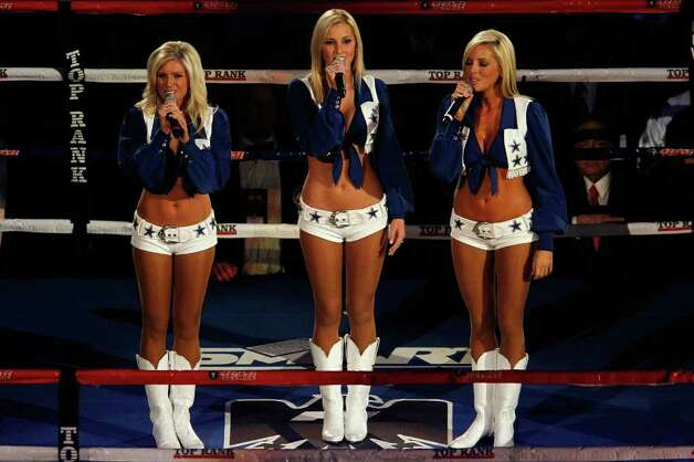 ARLINGTON, TX - NOVEMBER 13:  Members of the Dallas COwboys cheerleader perform the US National Anthem prior Manny Pacquiao of the Philippines fighting against Antonio Margarito of Mexico during their WBC World Super Welterweight Title bout at Cowboys Stadium on November 13, 2010 in Arlington, Texas. Photo: Tom Pennington, Getty Images / 2010 Getty Images