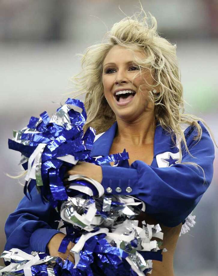 ARLINGTON, TX - SEPTEMBER 19:  A Dallas Cowboys Cheerleader performs during a game against the Chicago Bears at Cowboys Stadium on September 19, 2010 in Arlington, Texas. Photo: Ronald Martinez, Getty Images / 2010 Getty Images