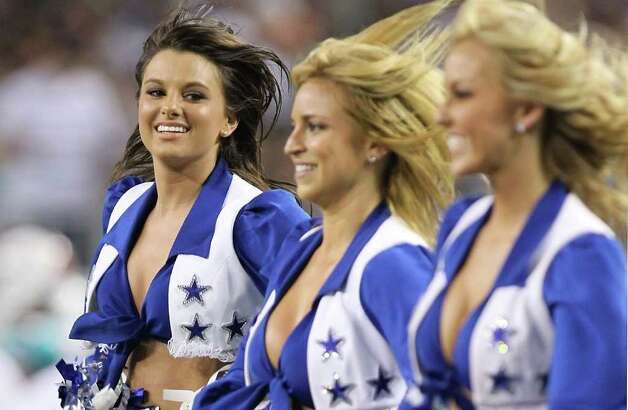 ARLINGTON, TX - SEPTEMBER 02:  A Dallas Cowboys cheerleader performs during a preseason game at Cowboys Stadium on September 2, 2010 in Arlington, Texas. Photo: Ronald Martinez, Getty Images / 2010 Getty Images
