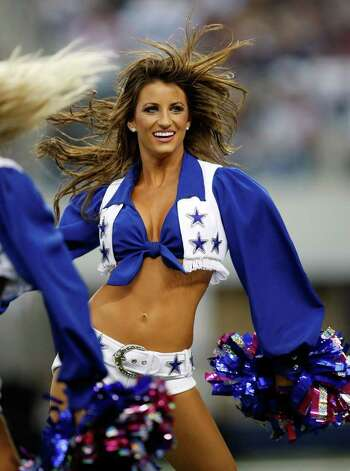 ARLINGTON, TX - NOVEMBER 01:  A Dallas Cowboys Cheerleader performs at Cowboys Stadium on November 1, 2009 in Arlington, Texas. Photo: Ronald Martinez, Getty Images / 2009 Getty Images