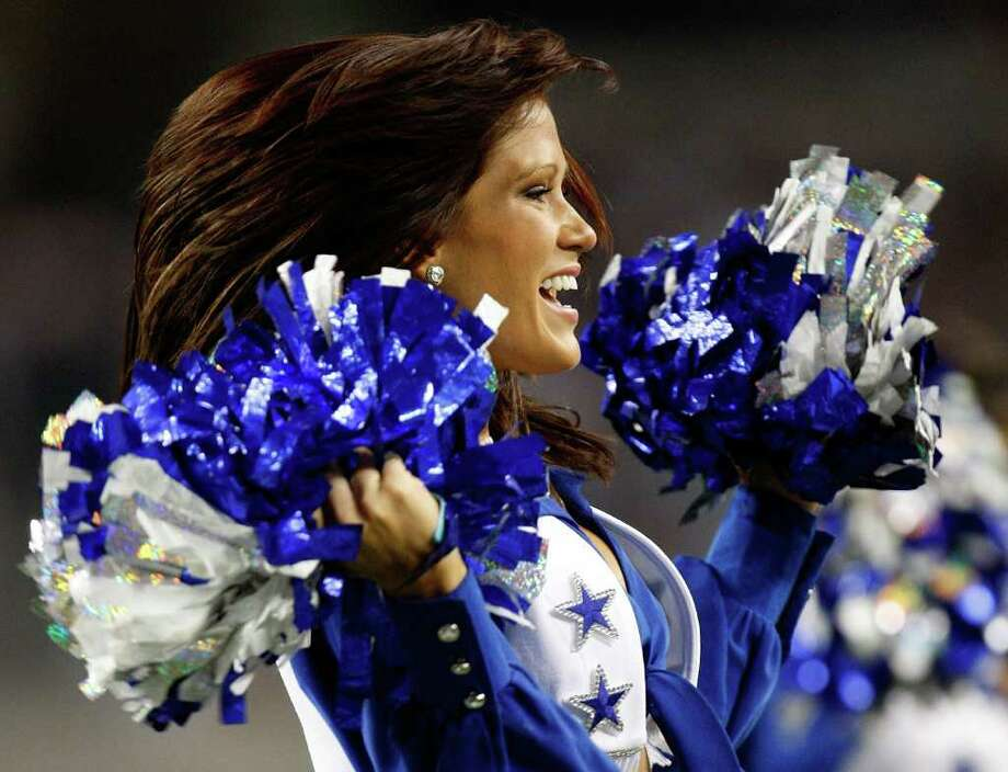ARLINGTON, TX - SEPTEMBER 28:  A Dallas Cowboys Cheerleader performs at Cowboys Stadium on September 28, 2009 in Arlington, Texas. Photo: Ronald Martinez, Getty Images / 2009 Getty Images