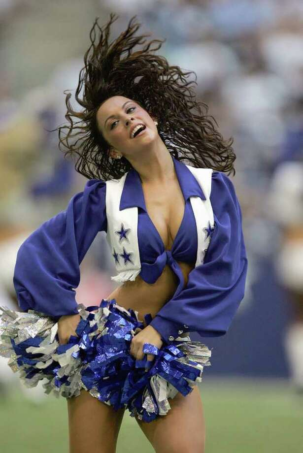 IRVING, TX - AUGUST 9: A Dallas Cowboys cheerleader performs on the field during the preseason game against the Indianapolis Colts at Texas Stadium on August 9, 2007 in Irving, Texas. Photo: Ronald Martinez, Getty Images / 2007 Getty Images