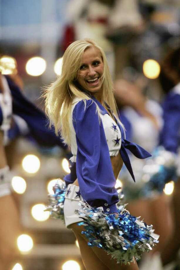 IRVING, TX - NOVEMBER 24:   A Dallas Cowboys cheerleader performs during the game against the Denver Broncos on November 24, 2005 at Texas Stadium in Irving, Texas.  The Broncos defeated the Cowboys in overtime 24-21. Photo: Ronald Martinez, Getty Images / 2005 Getty Images