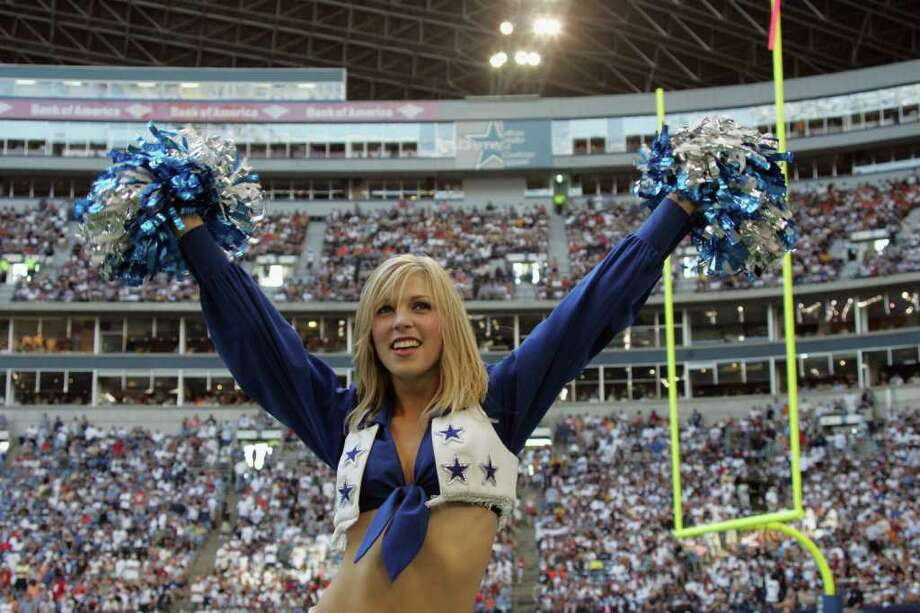 IRVING, TX - SEPTEMBER 19:  A Dallas Cowboys cheerleader performs during the game against the Cleveland Browns at Texas Stadium on September 19, 2004 in Irving, Texas.  The Cowboys won 19-12. Photo: Ronald Martinez, Getty Images / 2004 Getty Images