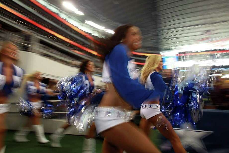 ARLINGTON, TX - NOVEMBER 24:  A Dallas Cowboys cheerleader performs during the Thanksgiving Day game at Cowboys Stadium on November 24, 2011 in Arlington, Texas. Photo: Ronald Martinez, Getty Images / 2011 Getty Images