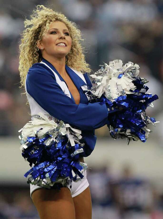 ARLINGTON, TX - NOVEMBER 13:  A Dallas Cowboys cheerleader peforms at Cowboys Stadium on November 13, 2011 in Arlington, Texas. Photo: Ronald Martinez, Getty Images / 2011 Getty Images