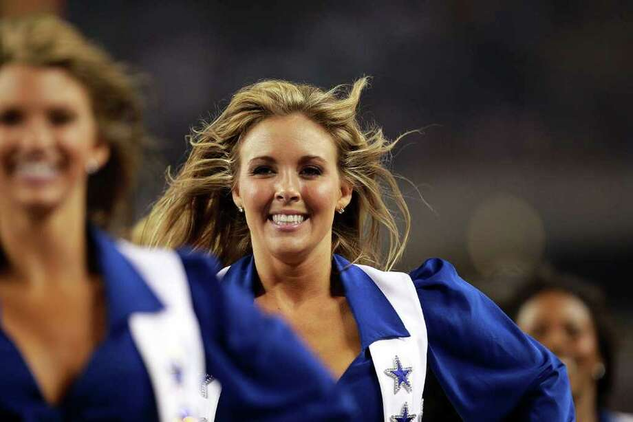ARLINGTON, TX - AUGUST 11:  A Dallas Cowboys Cheerleader performs at Cowboys Stadium on August 11, 2011 in Arlington, Texas. Photo: Ronald Martinez, Getty Images / 2011 Getty Images