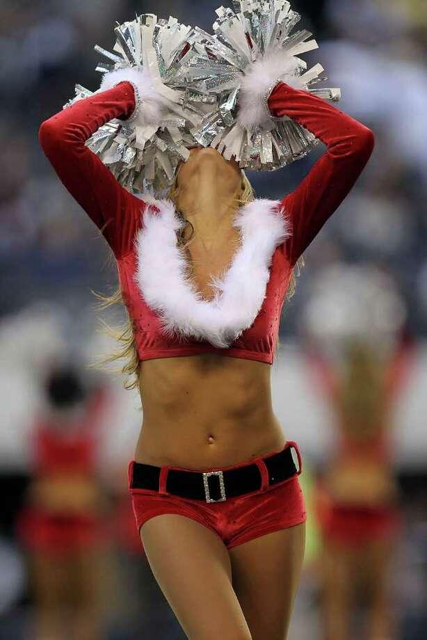 ARLINGTON, TX - DECEMBER 19:  A Dallas Cowboys Cheerleader performs at Cowboys Stadium on December 19, 2010 in Arlington, Texas. Photo: Ronald Martinez, Getty Images / 2010 Getty Images