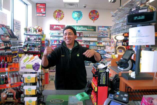 Walter Valenzuela, assistant manager at Shippan Point BP in Stamford, Conn., talks on Monday November 28, 2011 about finding out that that the winning Powerball ticket for $245 million dollars was sold at the gas station. Photo: Dru Nadler / Stamford Advocate Freelance