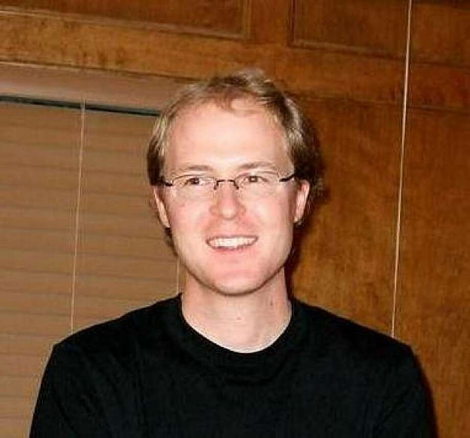 This undated photo provided by Tesla Motors on Thursday, Feb. 18, 2010 shows Andrew Ingram, 31, an electrical engineer and a two-and-a-half-year employee of the company. Ingram and two other colleagues were killed on Wednesday, Feb. 17, 2010, after the twin-engine Cessna 310 they were on crashed in East Palo Alto, Calif. (AP Photo/Tesla Motors)   Ran on: 02-19-2010 Andrew Ingram Photo: AP