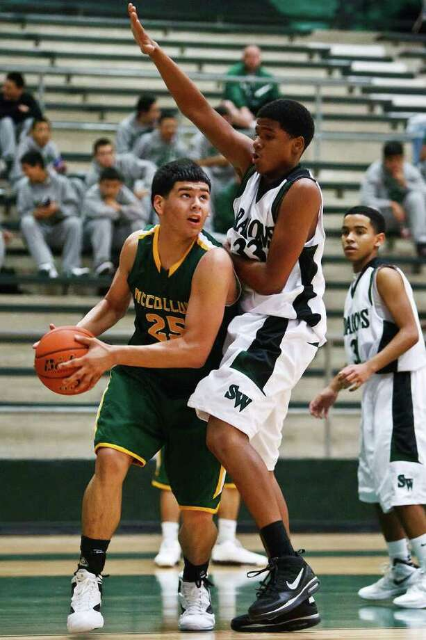 McCollum's Adam Salinas (left) looks for a shot under the basket around Southwest's Aaron Embrey as Nigel Thompson looks on goes up for a shot over Southwest's Lorenzo Gonzalez (15) and Aaron Embry during the third quarter of the Cowboys' 63-49 victory over Southwest. Photo: MARVIN PFEIFFER, Photo By Marvin Pfeiffer / Prime Time Newspapers 2011