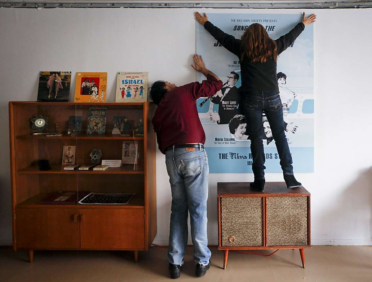 David Katznelson and his wife, Barbara, hang a poster in Tikva Records, the world's first Jewish pop-up record store, on Friday, Nov. 18, 2011 in San Francisco, Calif. The store is scheduled to open on December 1.