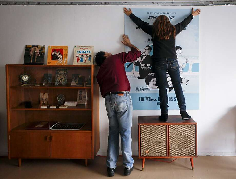 David Katznelson and his wife, Barbara, hang a poster in Tikva Records, the world's first Jewish pop-up record store, on Friday, Nov. 18, 2011 in San Francisco, Calif.  The store is scheduled to open on December 1. Photo: Russell Yip, The Chronicle