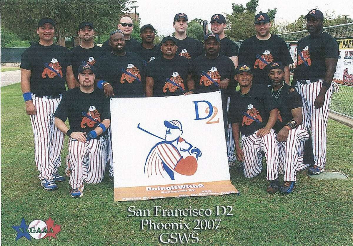 The D2 softball team of San Francisco, which was disqualified from a gay softball tournament after three players' sexual orientation was questioned. The three have sued. They are Steven Apilado (kneeling, second from right), Jon Russ (standing, first from left in front row), and LaRon Charles (standing, center player in front row). Photo courtesy National Center for Lesbian Rights. Ran on: 04-22-2010 Steven Apilado (kneeling, second from right), Jon Russ (holding banner at left) and LaRon Charles (center, next to Russ) are plaintiffs in the lawsuit.