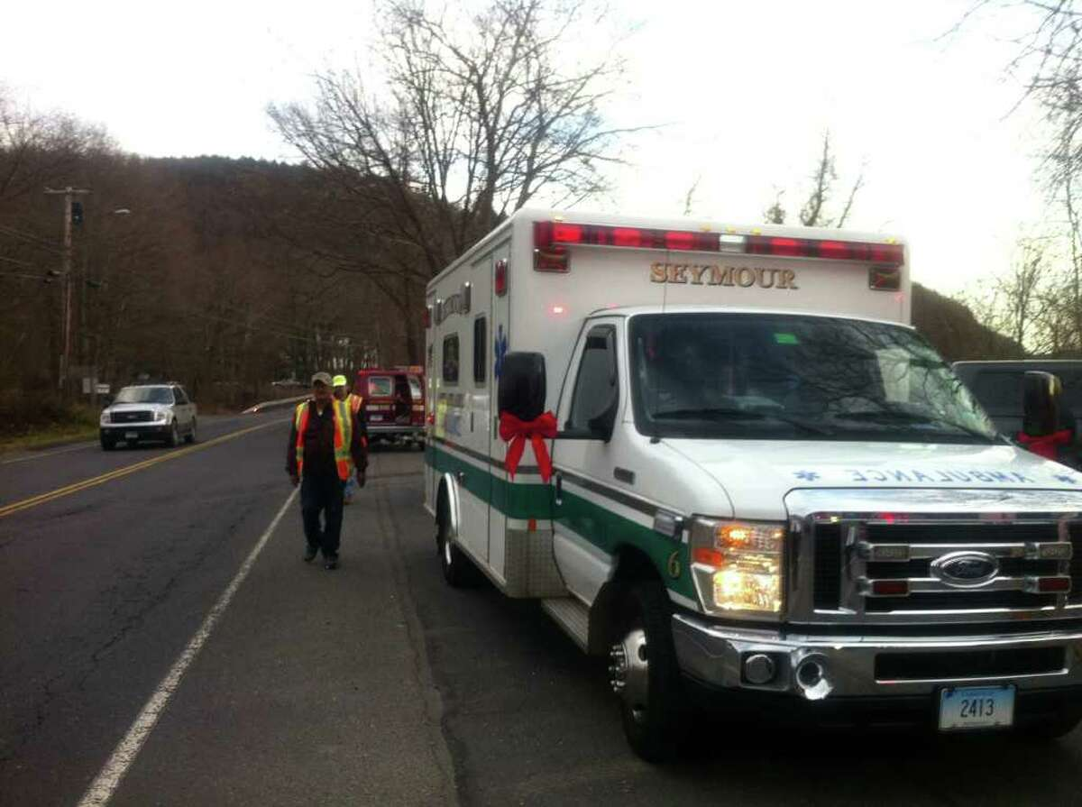 Emergency crews in Seymour, Conn. respond to the Housatonic River on Monday, Nov. 28, 2011 to search for a possible missing boater after a boat was found capsized just before 2 p.m.