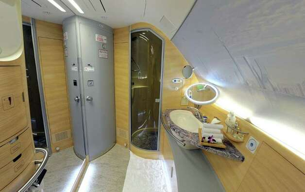 with shower is pictured on the upper deck of an Emirates Airbus A380    Emirates First Class A380 Suite