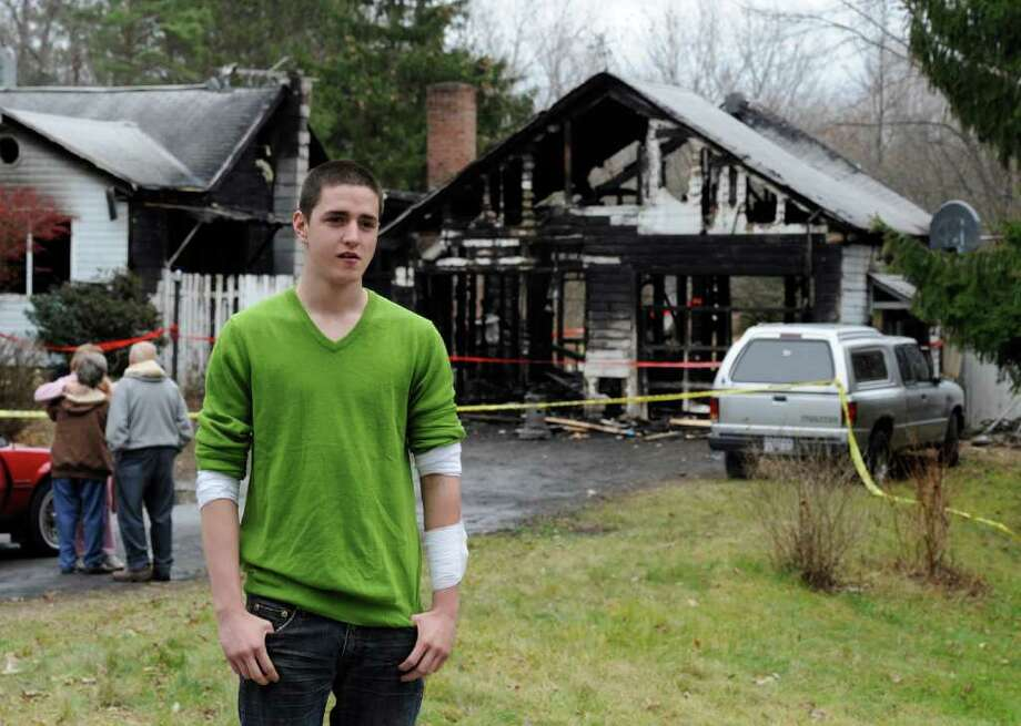 Raleigh Powell II, who was instrumental in saving the occupant's life, stands in front of 267 Lapp Road in Clifton Park, N.Y. Nov. 28, 2011 after a fire struck the house.   (Skip Dickstein / Times Union) Photo: SKIP DICKSTEIN / 2011