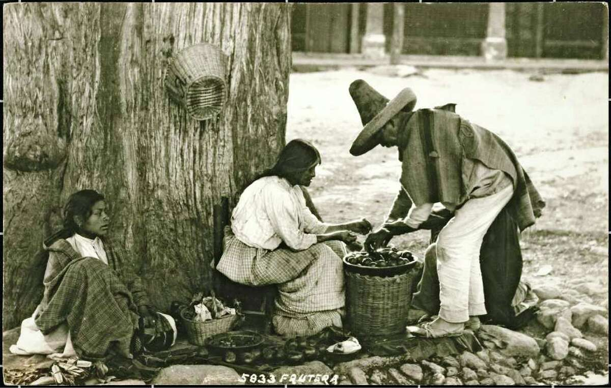 """A photo of a fruit seller by photographer Hugo Brehme, the subject of a new book from UT Press, """"Timeless Mexico,"""" by San Antonio author and collector Susan Toomey Frost."""